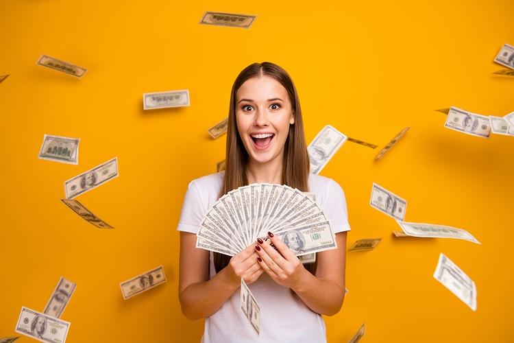 Smiling Girl Winning Money